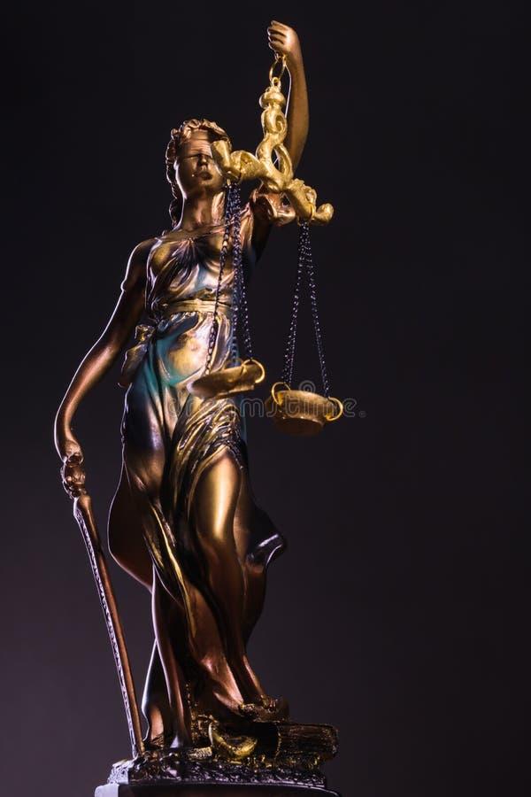 Photography of bronze themis sculpture, femida or justice goddess on dark background stock image