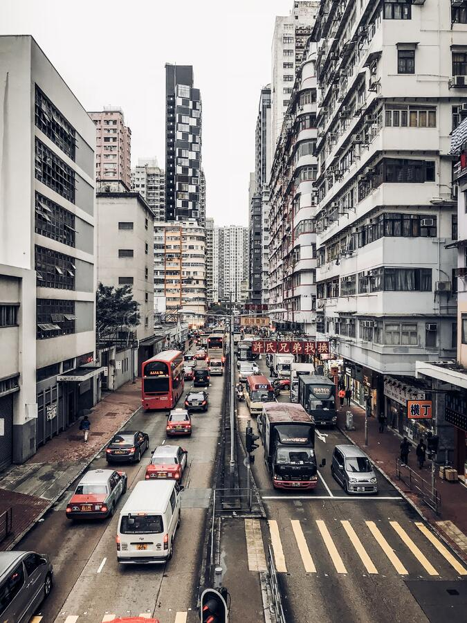 Photography of Buildings and Cars on Road royalty free stock photo