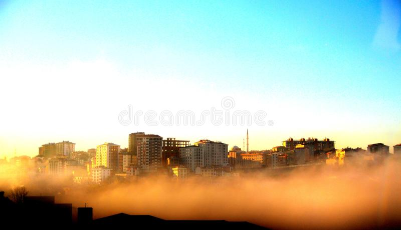 Photography of Buildings on a Foggy Morning stock photography