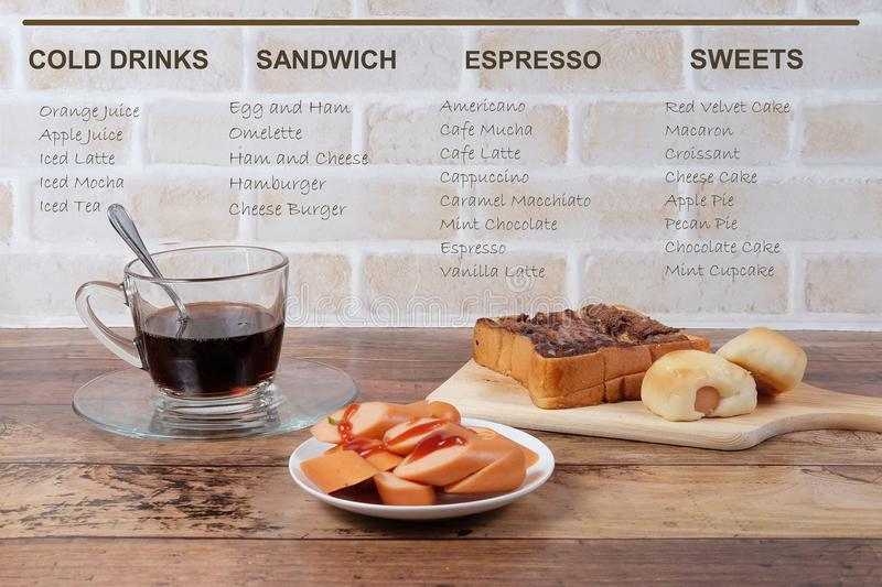 Scenery of cafeteria Menu. Photography of cafeteria foods on the wooden table in front brick wall royalty free stock image