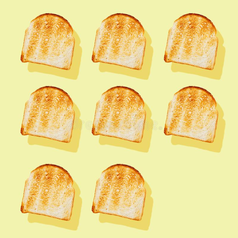 Photography collage of toasted bread on pastel yellow background top view flat lay isometric food pattern stock photography