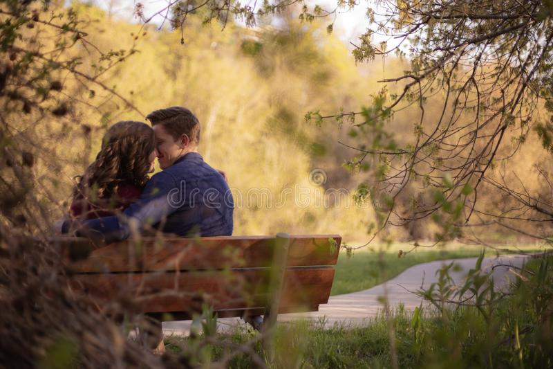 Photography of Couple Sitting on Bench stock image