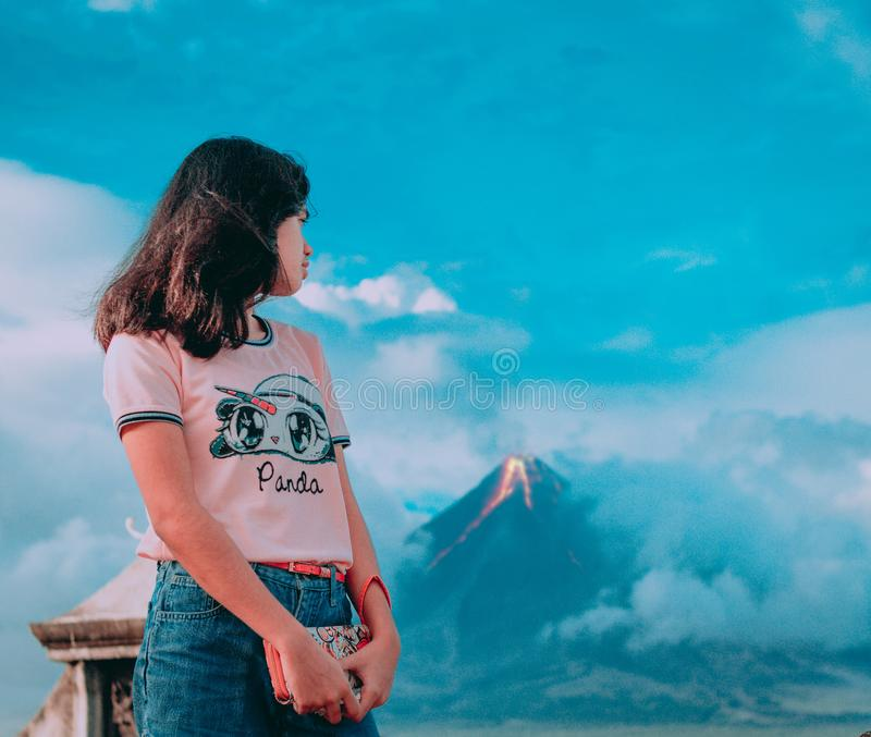 Photography of a Girl In Front of Erupting Volcano stock photos
