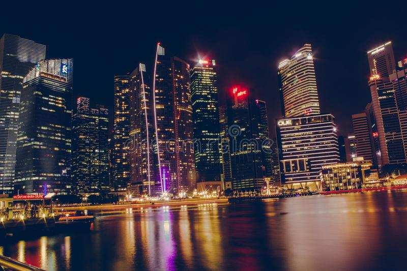 Photography Of High-Rise Building At Night Time stock photography