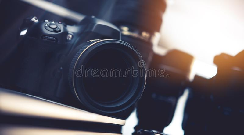 Photography Industry Equipment. Modern Digital Photo Camera and Lenses royalty free stock image