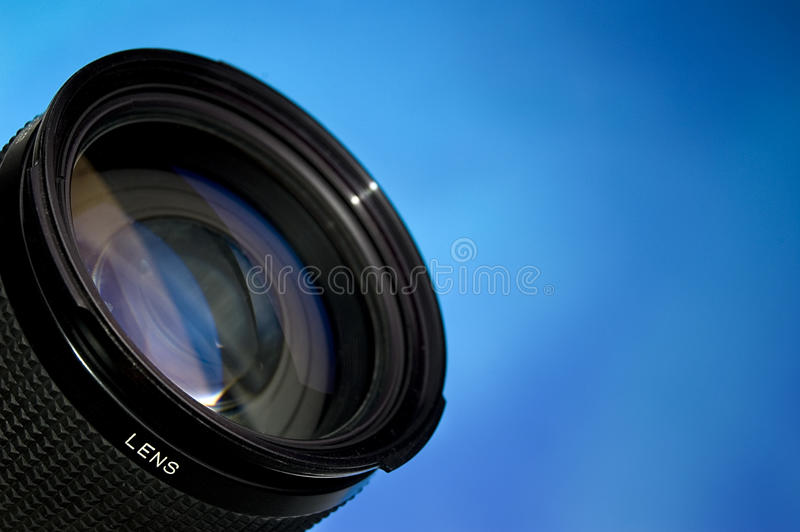 Photography lens over blue royalty free stock photo