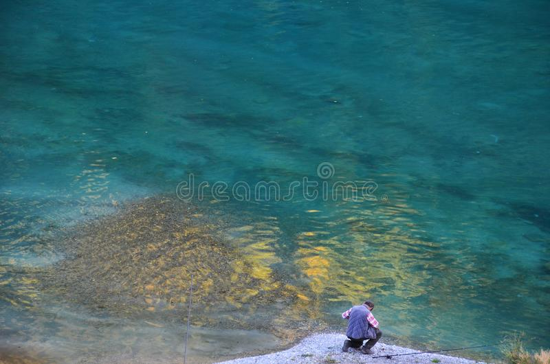 Photography of a man fishing royalty free stock photo