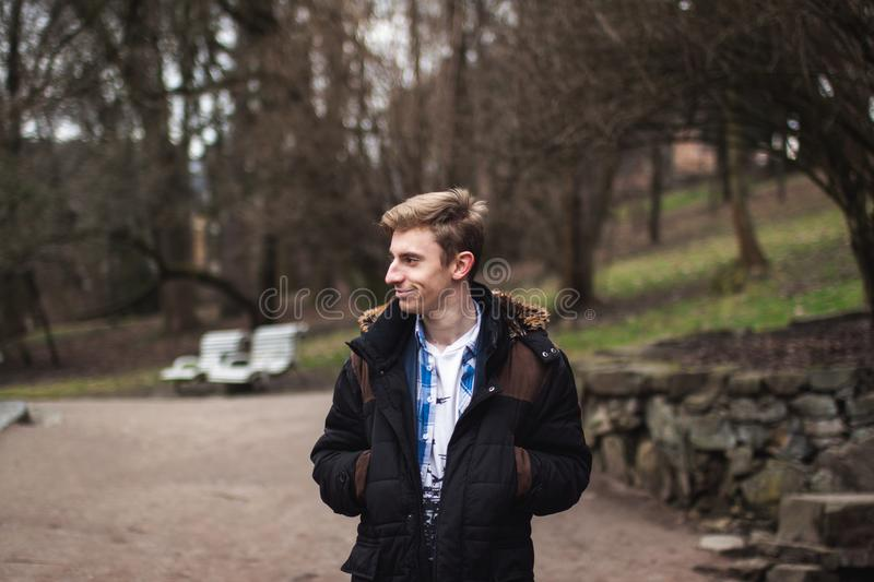 Photography of a Man Wearing Black and Brown Jacket royalty free stock photos