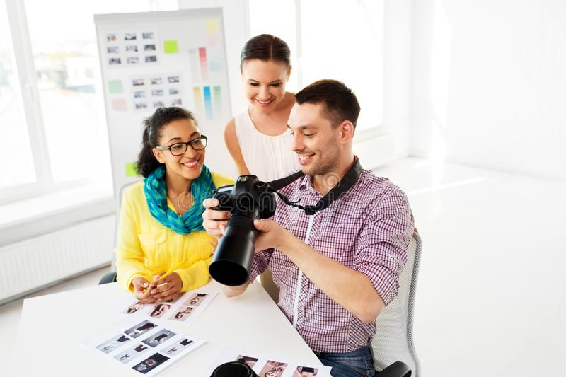 Photographers with camera at photo studio stock image
