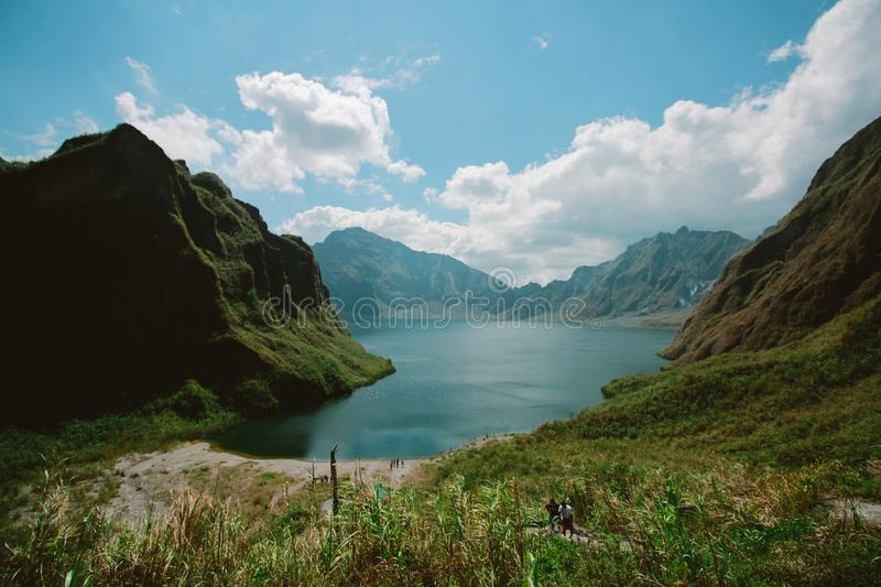 Photography of Mountains Near Body of Water stock photos