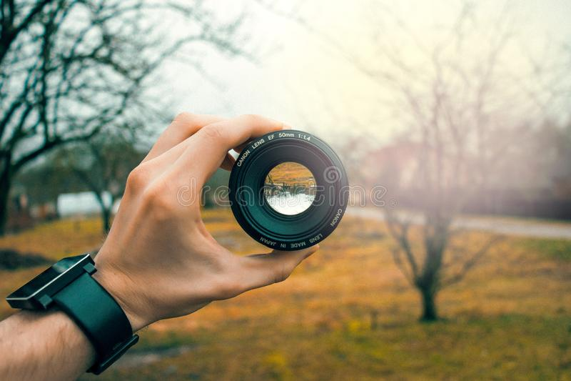 Photography of Person Holding Black Camera Lens royalty free stock photos