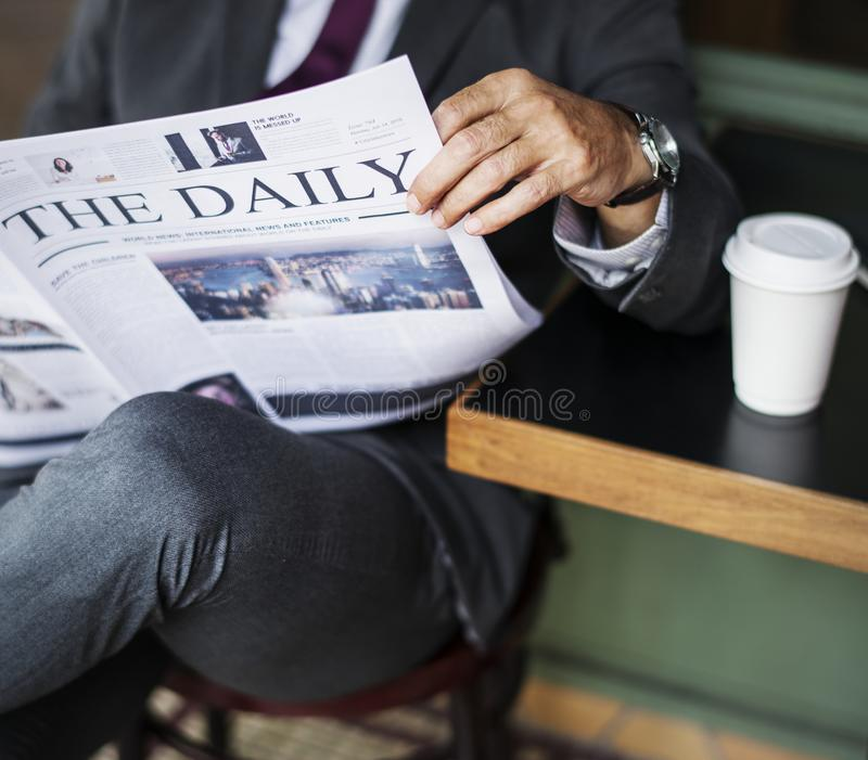 Photography of a Person Reading Newspaper royalty free stock photo
