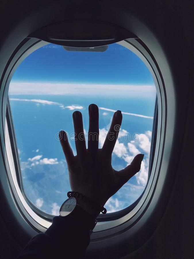 Photography of Person's Left Hand Touching an Airplane's Window stock photos