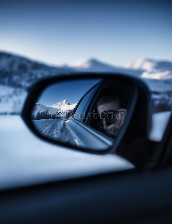Photography in the rearview mirror. Travel by car in the mountains. Landscape in winter. Norway - travel royalty free stock images