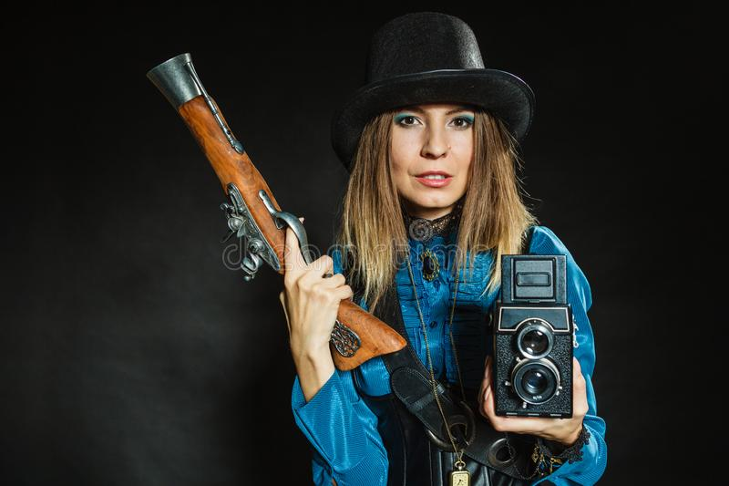 Steampunk with old retro camera and pistol royalty free stock photos