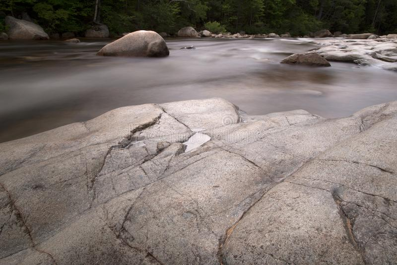 Photography of Rock Formation on Body of Water stock photos