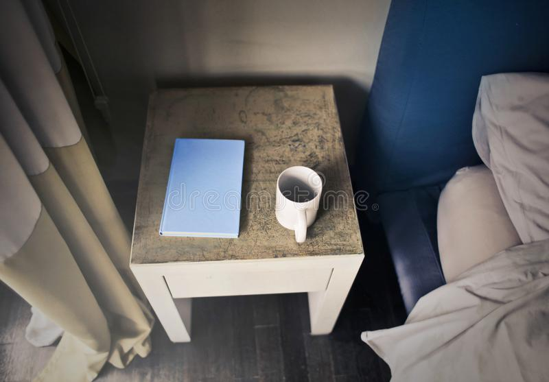 Photography of Side Table Near Bed royalty free stock photography