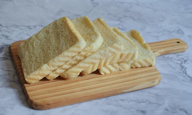 Photography of Sliced Bread on Chopping Board stock photo