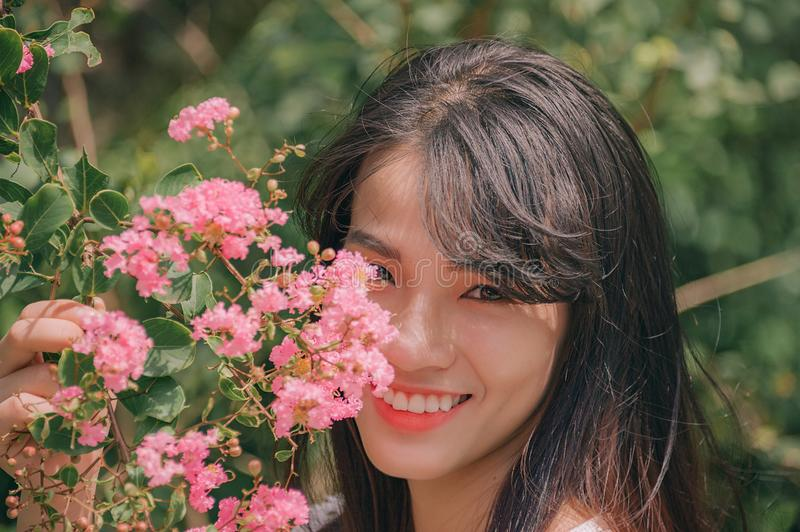 Photography of Smiling Woman Near Flowers royalty free stock photo