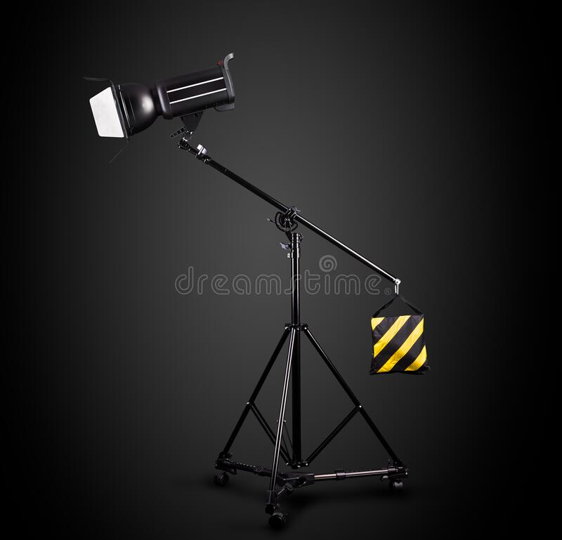 Free Photography Studio Flash On A Lighting Stand Isolated On Black Background Royalty Free Stock Image - 177057156