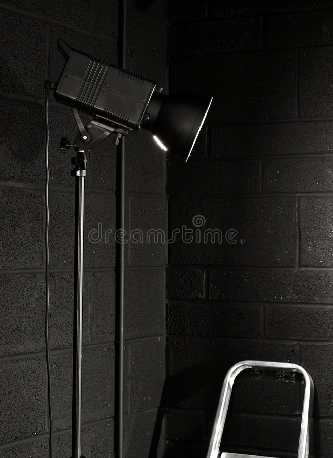 Download Photography Studio Light Against A Black Brick Wal Stock Photo - Image of equipment, glow: 5046700