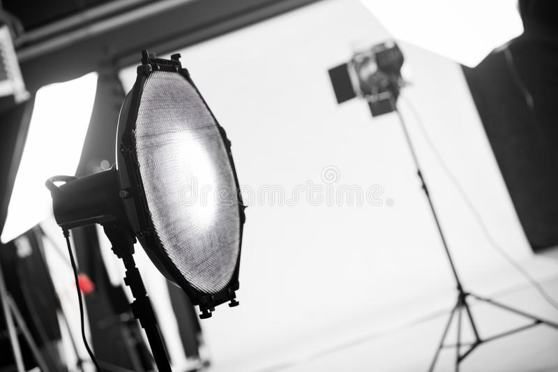 Photography studio with professional lighting equipment. Focus on a beauty dish with a grid royalty free stock images