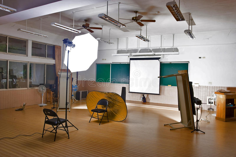 Photography studio setup. Photography classroom studio setup with reflectors, lighting and backdrops royalty free stock images