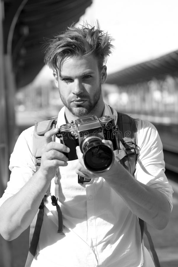 Photography and tourism concept. Tourist takes picture of cityscape. Man with beard royalty free stock images