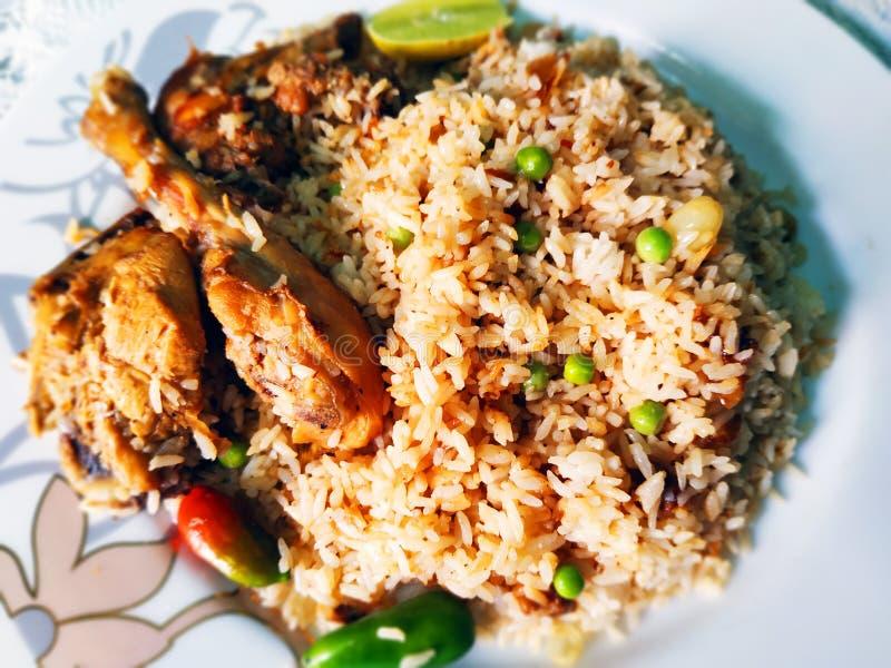 Traditional delicious food chicken Biryani. Photography of traditional delicious food in South Asia Biryani. It is chicken Biryani, famous Moglai spicy food royalty free stock photos