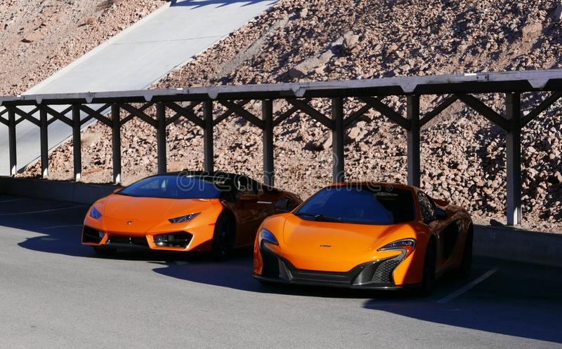 Photography of Two Orange Sports Car royalty free stock image