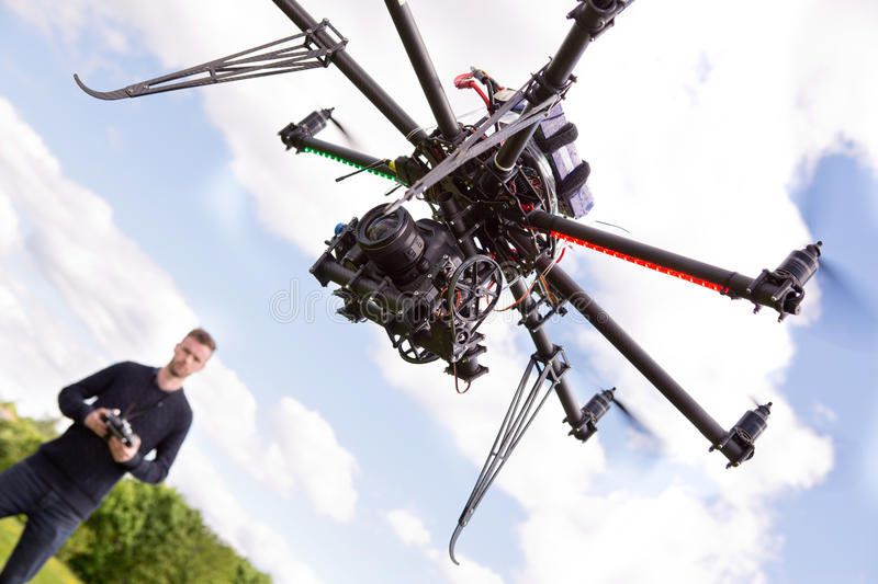 Photography UAV. Photographer flying rc controlled photography drone with 2 axis gimbal royalty free stock image