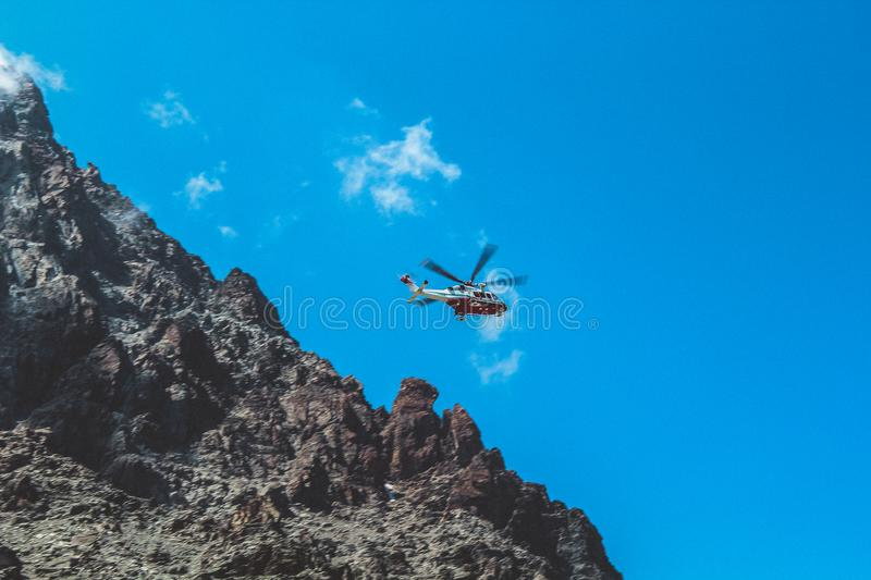 Photography of White and Red Helicopter Flying stock photography