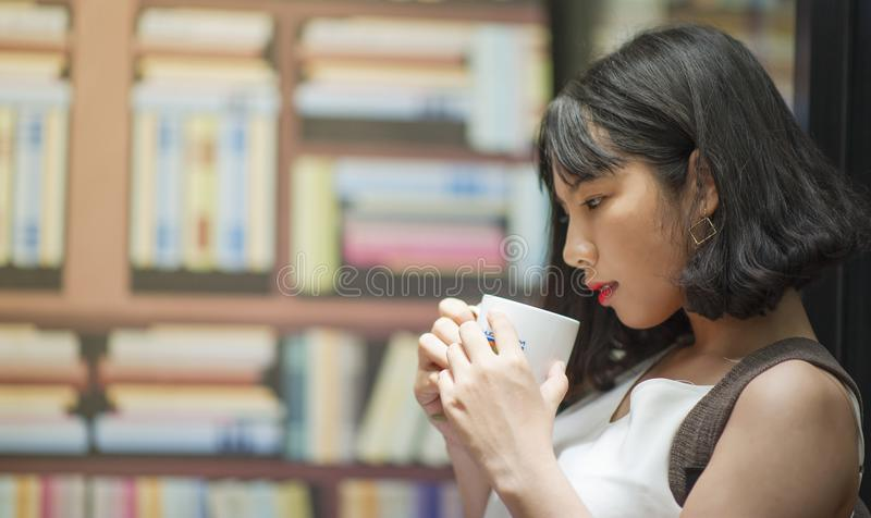 Photography of A Woman Holding White Coffee Mug stock image