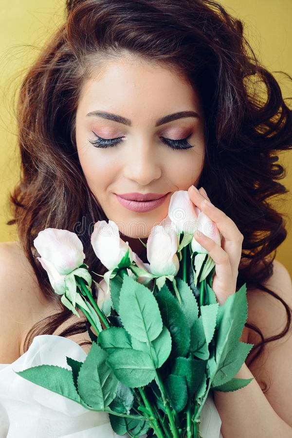 Photography of a Woman Holding White Flowers royalty free stock photo
