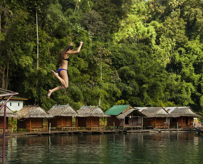 Photography of a Woman Jumping Into The Water stock images