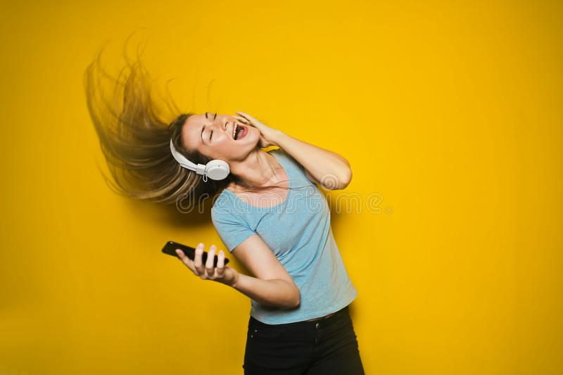 Photography of Woman Listening to Music stock images