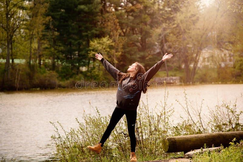 Photography of a Woman Near Lake royalty free stock photo