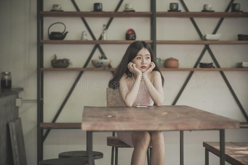 Photography of a Woman Sitting on The Chair Listening to Music stock photography