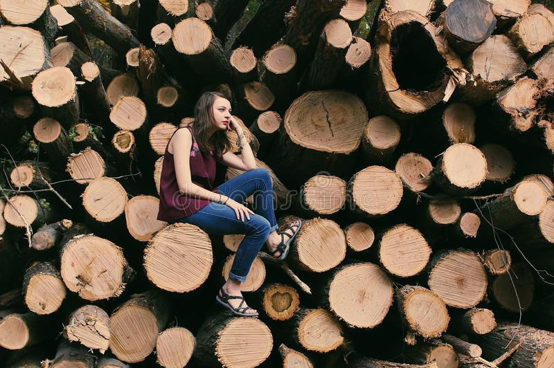 Photography of a Woman Sitting on a Log royalty free stock photos