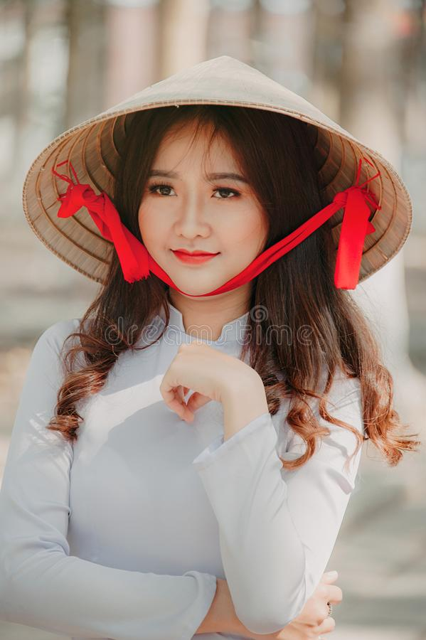 Photography of a Woman Wearing Asian conical hat royalty free stock images