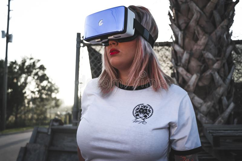 Photography of a Woman Wearing Virtual Reality Headset royalty free stock images