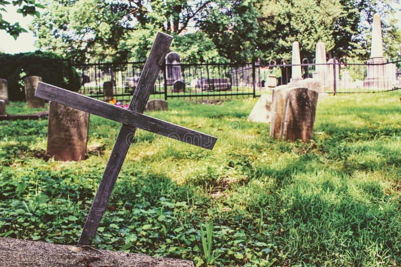 Photography of Wooden Cross on Green Grass royalty free stock photo