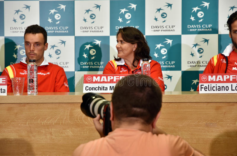 Photojournalist photographing tennis press conference royalty free stock photo