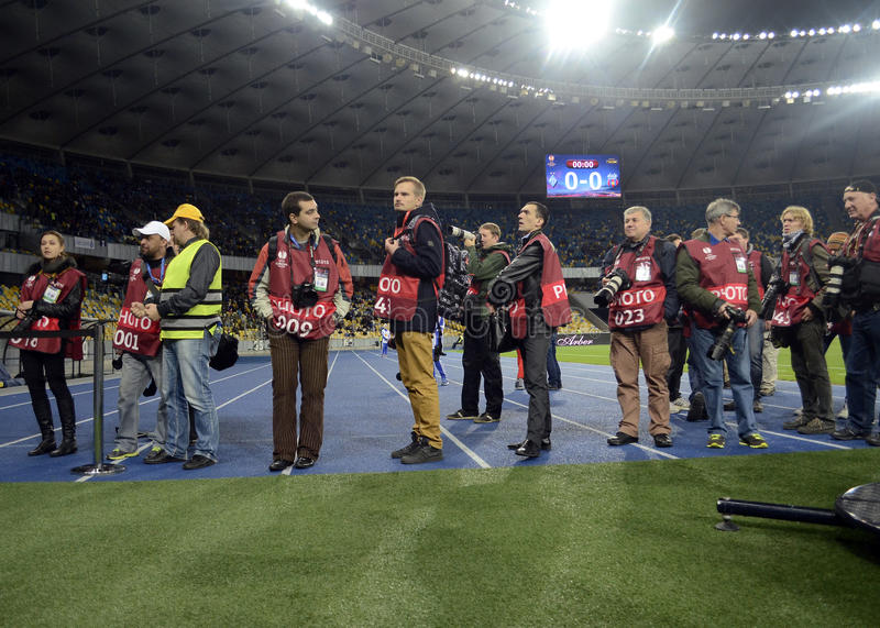 Photojournalists at work during Champions League football game. Photojournalists at work waiting for the players to come out on the pitch for the UEFA Champions royalty free stock image