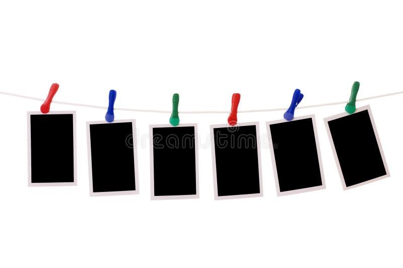 Photos blanc s'arrêtant sur une corde à linge photographie stock libre de droits