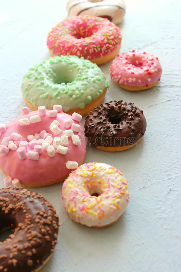 Photos of different donuts, free space for writing texts. Photos of different donuts. Assorted colorful donuts in glaze close-up, free space for writing textsn stock photo
