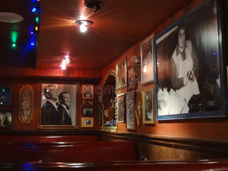 Photos of Frank Sinatra, Dean Martin, Luciano Pavarotti, and other Italian Legends inside Buca di Beppo Restaurant. San Francisco - June 13, 2011:  Photos of royalty free stock images