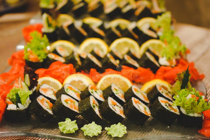 Photos of fresh sushi dishes with great variety. Selective focus on the beginning of the dish. Horizontal colorful, bright frame.  royalty free stock photo