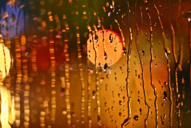 Photos night city made through glass. Street. Rain. stock image