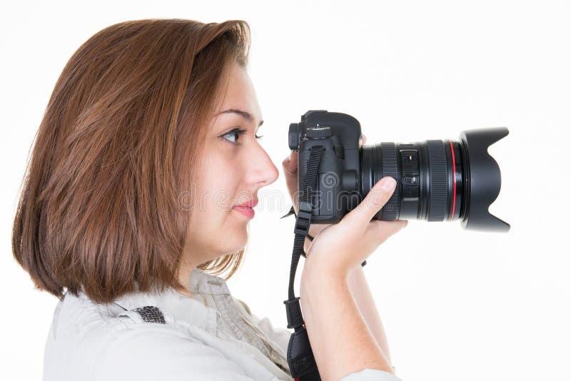 Photos parlantes de profil de jeune femme à l'arrière-plan blanc photographie stock libre de droits